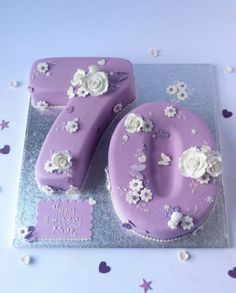Birthday cake in the shape of a number 70 in lilac with white fondant flowers by Karen's Cakes 70th Birthday Cake For Men, Number Birthday Cakes, Butterfly Birthday Cakes, Number Cakes, Themed Birthday Cakes, Fondant Numbers, Foundant, Wedding Anniversary Cakes, Beautiful Birthday Cakes