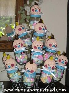 Cute baby shower decoration - made out of old baby food jars and put in a cupcake stand
