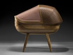 Noir Vif and Ludwig et Dominique design a baby cradle. The crib made of walnut and copper provides protection against electromagnetic waves. Walnut Timber, Contemporary Cabinets, Electromagnetic Radiation, Argo, Cabinet Making, Futuristic Design, Interior Trim, Baby Cribs, Tub Chair