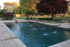 Paver Pool Decks in Haymarket, VA | Custom Pergolas | Berriz Design