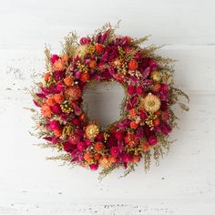 "Hand-crafted from an abundance of dried blooms, this vibrant circlet brings the garden indoors throughout the seasons.- Gomphrena, English statice, cockscomb, golden tansy, Sweet Annie artemisia, German statice- Indoor use only- Handmade in the USA3.5""D, 12"" diameter"