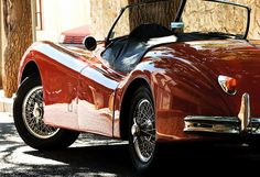 kendrasmiles4u:  Red Jaguar XK140 by pedrosimoes7 on Flickr.