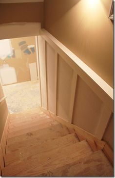 basement board and batten--this is a great idea instead of following the angle of the stairs and trying to match angles and seams! Love it!!