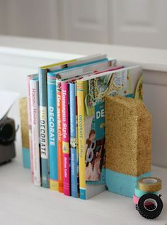 Paint two discarded bricks and use them as bookends.