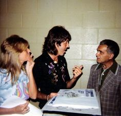 """Jack Kirby meeting Paul & Linda McCartney at a Wings show at the LA Forum in 1976.   Paul dedicated """"Magneto and Titanium Man"""" to Jack at the show. In return, Jack gave Paul this piece of art."""