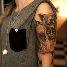 Girl with bear head tattoo