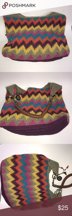 """The Sak Purse Shoulder Bag Multicolor The Sak woman's purse. Multicolor outer crochet look. Large inner compartment with 2 side pockets and 1 zip pocket. Think brown strap with sturdy hardware and beads. The lining is slightly worn. I Approx. measurements are: width 13""""; depth 4""""; height 11"""". (Y2-17)      No holes, piling or stains. Items stored in smoke free, pet free, perfume free environment. No trades or modeling. Same or next day shipping.  Save by bundling. All offers should be…"""