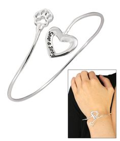 Save a Stray Heart & Paw Bracelet  Item #42179. Making their way off the streets, out of the shelter, and straight to your heart, they step over the threshold and the lives of the both of you are changed forever. Celebrate the unbound joy of a welcomed animal friend with a pretty bracelet full of heart and paw.    Silver-tone metal  Approximately 3 dia (7.6 cm)  Imported