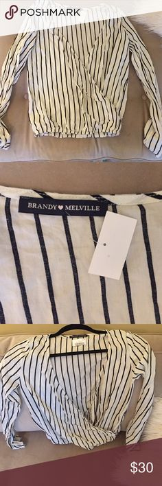 brandy melville top striped black and cream deep v shirt. it is a wrap top so the two pieces that create the v are not attached until the very bottom. new worn with tags! from brandy melville us online store. Brandy Melville Tops Blouses