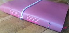 Dusky Rose Pink Ladies leather golf journal with Golf Score Card pages to log and record your game. Personalised for a great golfing gift by BespokeBindery
