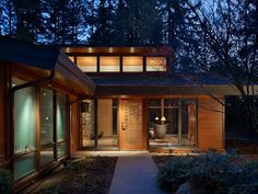 A wooded glass pavilion in the forest-The spectacular Lake Forest Park Residence is a renovation of an existing 1950's Northwest Contemporary house on a secluded, wooded site about 25 miles north of Seattle, Washington designed by Finne Architects.