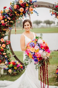 Sophisticated bride at her Summer colorful wedding arch decorated with flowers and oversize bridal bouquet - Bohemian Road Photography | Colorful Wedding Flowers Pop Agains Teal Bridesmaid Dresses - Belle The Magazine Floral Wedding, Wedding Colors, Wedding Bouquets, Wedding Flowers, Teal Bridesmaid Dresses, Dream Wedding, Wedding Day, Road Photography, Sophisticated Bride