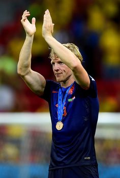 Dirk Kuyt of the Netherlands acknowledges the fans after defeating Brazil 3-0 during the 2014 FIFA World Cup Brazil Third Place Playoff match between Brazil and the Netherlands at Estadio Nacional on July 12, 2014 in Brasilia, Brazil.