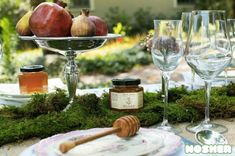 Rosh Hashanah tablescape with moss and honey stick