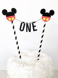 Mickey Mouse First Birthday Cake Topper / Mickey Mouse Cake Bunting / Cake Banner / Mickey Mouse Clubhouse 1st Birthday Party / One by GlitterDesignsCo on Etsy https://www.etsy.com/listing/499376363/mickey-mouse-first-birthday-cake-topper