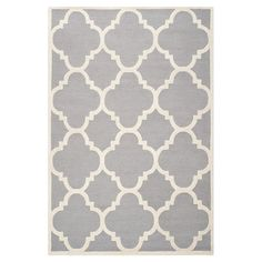 Tufted wool rug with a quatrefoil motif. Made in India.  Product: RugConstruction Material: WoolColo...