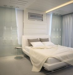 Amazing An Apartment with Soft Hue in a Futuristic Design Theme: Modern White Futuristic Tranquility Apartment Bedroom Interior With Metalic Accents ~ anahitafurniture.com Apartment Inspiration