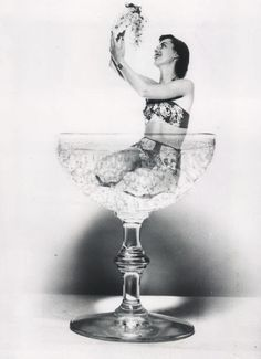 Model Patty Kent in a glass of Sparkling California Champagne 1950