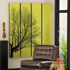 Poetry of Trees Artwork - Revive slumbering walls with this captivating Poetry of Trees Artwork. A lone, majestically shaped shade tree in full silhouette is boldly rendered across four separate canvases, and vibrant green brushwork highlights the tree's magnificent shape.