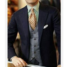 Great combination of blues, greys, greens and orange. http://www.memysuitandtie.com/