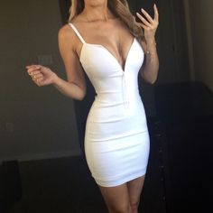 ✨Restocked✨ The White Mini Price is FIRM unless bundled, no trades. Not from listed brand, Boutique brand, New without tags! The White Mini features stretch bodycon fabric, spaghetti straps, a plunging neckline, and a short cocktail length. Fiber Content: Rayon Nylon and Spandex My Stats: 34-25-35 I am wearing a Medium. Made in the USA❤️ bebe Dresses Mini