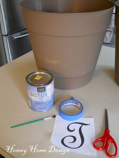 How to transfer a letter to the plastic flower pot.
