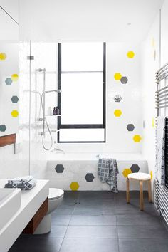 """Cheery yellow feature tiles are a much-loved feature of the children's bathroom, Hexatile ceramic **wall tiles** from [Academy Tiles](http://academytiles.com.au/?utm_campaign=supplier/