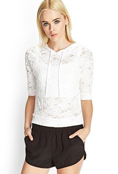 Sporty and femme, this sheer floral lace top features an attached drawstring hood and 3/4 sleeves.