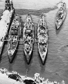 USS Flying Fish, USS Spadefish, and USS Bowfin in port with USS Tinosa approaching, Pearl Harbor, 4 Jul 1945