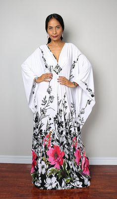 An amazing long trendy kaftan, which stands out from the crowd because of its contemporary design and gorgeous floral print.  A glamour dress like you