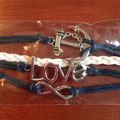 Anchor Chain Infinity Love Navy Wrap Bracelet NEW Brand new in package! Love Infinity Anchor Chain PU Leather/Suede bracelet with silver toned hardware. Adjustable chain to fit different sizes. Comes from a smoke-free home! Boutique Jewelry Bracelets