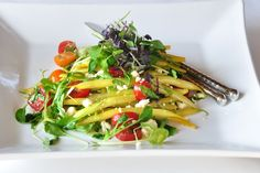 Yellow summer beans, cherry tomatoes and feta salad.
