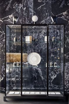 10 by Yatzer installation view at Spazio Pontaccio,Milan 2016. Wunderkammer High Display Case by Piero Lissoni for Glas Italia.Materials Wallpaper in black marble by Piet Hein Eek for NLXL.Styling by Costas Voyatzis, photo by Fabrizio Annibali.