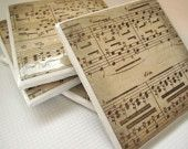 Sheet music on simple ceramic tiles, felt on the bottom, makes lovely coasters! Use music from your favorite symphony, that was played in your wedding, etc.