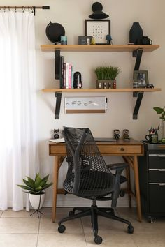 Small Space Design Solutions in a Tiny Studio Apartment Apartment Desk, Apartment Therapy, Tiny Studio Apartments, Tiny Office, Interior Design Books, Walnut Floors, Small Space Design, Glass Cabinet Doors, Tiny Spaces