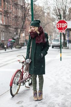 Consider wearing a dark green coat and green camo skinny jeans to effortlessly deal with whatever this day throws at you. Rock a pair of tan suede wedge sneakers for a more relaxed aesthetic.  Shop this look for $211:  http://lookastic.com/women/looks/beanie-scarf-coat-gloves-crossbody-bag-skinny-jeans-wedge-sneakers/7057  — Dark Green Beanie  — Burgundy Knit Scarf  — Dark Green Coat  — Grey Wool Gloves  — Brown Leather Crossbody Bag  — Green Camouflage Skinny Jeans  — Tan Suede Wedge ...