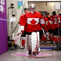 Here comes the cavalry ... Team Canada led by Carey Price for the gold medal game against Sweden. #Sochi2014