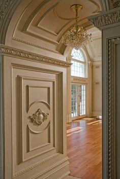 French Rineau scroll, recessed rope paneled, four-foot deep barrel-raised panel ceiling archway has Mon Reale Acanthus Crown molding, creates a seamless elegant columned entrance — with Andrea DAlessio Jr.
