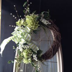 ~Spring and Summer grapevine oval wreath The width is 22 inches across and with the tips of the flowers its 33 inches in height  ~apple