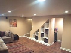Perfect idea for utilizing the space under the basement stairs, whil  leaving a doorway open