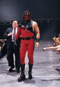 "Strange videos featuring Kane's former mask set on fire have announced the Big Red Machine's ""resurrection."" Take a look through the years Kane spent terrorizing WWE while wearing the horrific mask. Wrestling Stars, Wrestling Wwe, Kane Wwf, Wwe Lucha, Paul Bearer, Wwe Ppv, Chris Benoit, Alice In Wonderland 1, Undertaker Wwe"