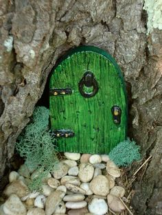 Love the idea of putting these at the bottom of some of the trees in our yard.  :)   FAIRY DOOR  The Teaching Door  Die Stone by FairybehindtheDoor, $13.50
