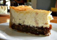 This hot buttered rum pecan pie cheesecake is a layer of rum cheesecake studded with toffee bits, baked over a pecan pie. It is over the top perfect anytime