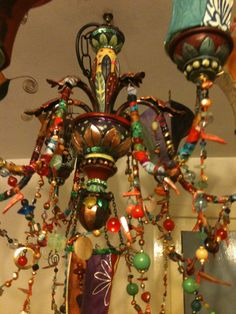 Mad hippy chandelier by LouiseTraill on etsy.