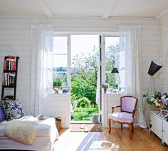 small and cozy space with lots of light and windows and access to a garden!  nauticalcottageblog.com