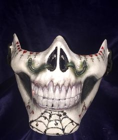 A personal favorite from my Etsy shop https://www.etsy.com/listing/253255254/sugar-skull-male-half-mask-dia-de-los