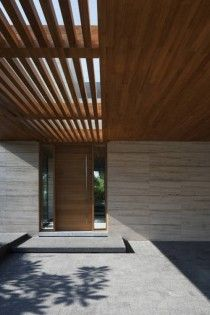 Travertine Walls with timber lined ceiling and pergola