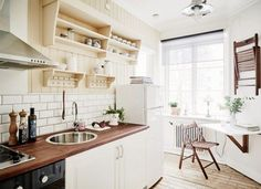 Small Swedish Kitchen -- clever design -- drop down table and hanging chairs provides a nice eating spot in this tiny kitchen. Kitchen Cabinetry, Kitchen Dining, Kitchen Decor, Kitchen Ideas, Design Kitchen, Dining Set, Dining Room, Small Kitchen Set, Kitchen Triangle