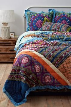 I'm loving the colors in this Anthropologie Wildfield Quilt, personally I'd put it in a room with grey walls, wooden floors (like above) and pick out one of the gorgeous colors to use as an accent in the room with a plain rug and a stunning art piece.