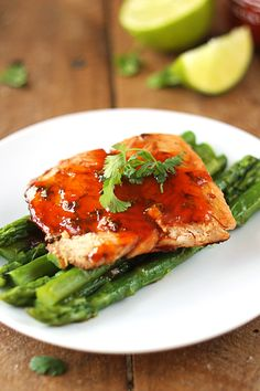 Sriracha Lime Salmon - Juicy, pan-seared salmon with a spicy and tangy sauce! An easy and healthy 30 minute meal that the whole family will love!
